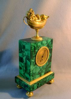 Russian malachite and gilt bronze mantel clock.