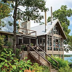 Great decorating ideas, love the wall of windows!  Lake House in the Trees | Alabama Lake House in the Trees |   June 2013 issue SouthernLiving.com
