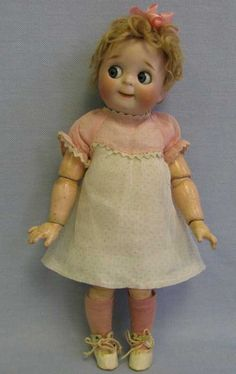 Kestner JD Dolls Doll with a round face and big, blue