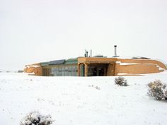 Earthship with neat entrance and snow