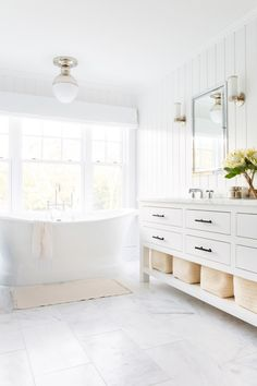 all-white bathroom + tub GOALS