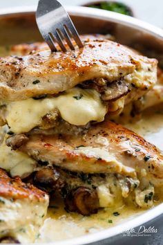 Cheesy Garlic Butter Mushroom Stuffed Chicken WITH an optional Creamy Garlic Parmesan Sauce! Garlic Mushroom lovers this is THE recipe of your dreams! | cafedelites.com