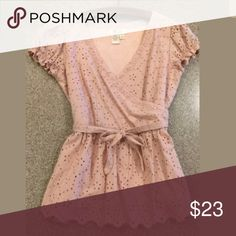 Anthropologie blush eyelet top Zips on side.  Fits like 0/xs. Perfect condition.  Brand is Aryeh. Aryeh Tops