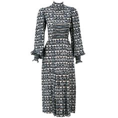 1970's Thea Porter Couture Art-Deco Smocked Print-Silk Dress   From a collection of rare vintage day dresses at https://www.1stdibs.com/fashion/clothing/day-dresses/