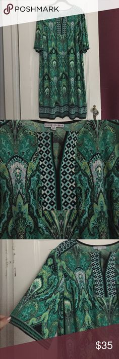 "Gorgeous green sheath dress Gorgeous greens in a beautiful pattern with a split neck and sleeves that go to right above the elbow. Bust 23"" flat with stretch, 41"" length. Great year round dress. Never worn but I took off the tags, perfect condition. Dresses"