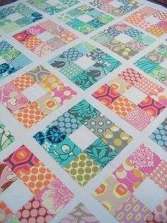 A nine patch, with bright colors, and white centers..