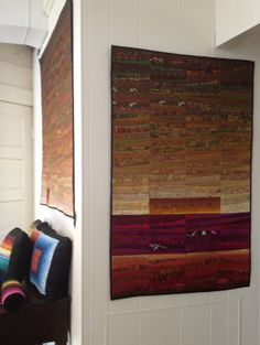 Sunrise in autumn quilted wall hanging 32x48 inches by AnnBrauer. I love how the warmth of the sun rise reflects the richness of the colors in autumn. #quilt