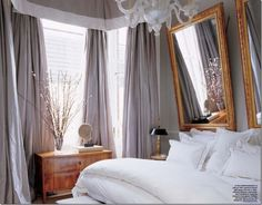 Hanging a mirror normally reflects the ceiling.  Hanging a mirror so that it leans forward reflects the room.  Use a chain.