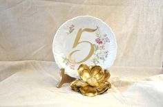 Create DIY vintage plate table numbers using calligraphy decals. http://www.etsy.com/listing/109514445/table-number-decals