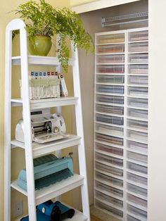 Also on the wall behind Leah's desk is this wood tiered shelving unit from Target where she stores bulky tools, such as her die-cutting machines and cartridges. The increasingly larger shelves accommodate the most items possible in that space./