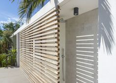 By adding wooden panels and steel railings to an existing house in Saint-Tropez, France, Vincent Coste reinvented its character. Mid Century Landscaping, Modern House Design, Facade, Swimming Pools, Blinds, Exterior, Landscape, Terrace Ideas, Gates