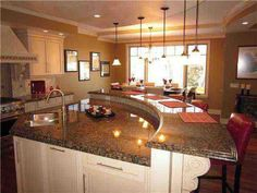 curved kitchen islands with seating | Top 5 Homes for sale in Briar Hill, NW Calgary