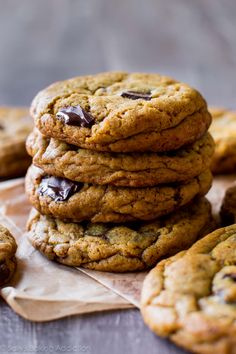Dense chewy centers, soft and toffee-flavored, filled with warm chocolate, and crisp edges! Chocolate chip cookies with less sugar on sallysbakingaddiction.com