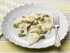 Four Cheese Ravioli with Herb Pesto recipe from Giada De Laurentiis. 5 of 5 Stars, 5 Reviews | Food Network. Note: Ravioli is made with wonton wrappers, ricotta, mascarpone, mozzarella and parmesan. Pesto has anchovies, basil, mint and parsley.