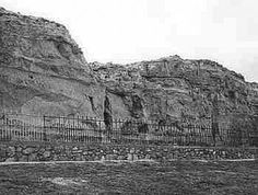 OREGON TRAIL -- south of Guernsey, WY -- Register Cliff. Wyoming SHPO photo.  Register Cliff rises more than 100 feet above the North Platte River Valley south of Guernsey, Wyo. The area was the first night camp west of Fort Laramie for Oregon Trail travelers. Under the shadow of the chalky limestone bluffs on the south bank of the river, the emigrants paused to set up camp, pasture their animals and rest from the hardships of the trail. The stopover gave them time to record their names