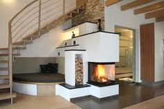 A modern house architecture style is famous with its innovative design. Home Fireplace, Modern Fireplace, Living Room With Fireplace, Fireplace Design, Home Living Room, Fireplace Ideas, Small Space Interior Design, Interior Design Living Room, Style At Home