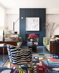 A Milo Baughman sofa and armchairs are upholstered in a Clarence House mohair.