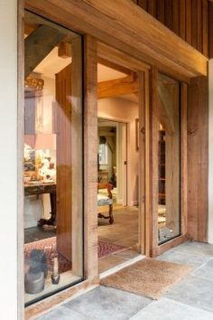 Very welcoming oak entrance to gorgeous oak framed home by Roderick James Architects.