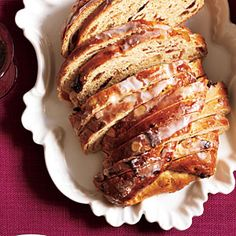 Christmas Stollen | MyRecipes.com Stollen is a traditional German Christmas yeast bread that's filled with dried fruit and topped with a sugary glaze and candied cherries. It's usually shaped into a folded oval and is a welcomed gift during the holidays.