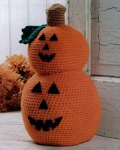 Halloween Doorstopper... Stacked Pumpkin Doorstop.. you'll need: Orange – 6 oz, 300 yds (171 g, 270 m),  Green – ¼ oz, 13 yds (8 g, 12 m), Brown – ¼ oz, 13 yds (8 g, 12 m), ... Black Felt, Fiberfill, 2 liter Soda Bottle.   Bottle is in the middle and sand, rice etc is added tot he bottle before hand to add weight to the door stop.  G hook was used.