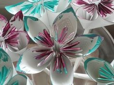 DIY: Folded Paper Flowers (Kusudama Origami) - YouTube (this was recommended on the blog 'pinstrosity' as one of the better videos for these flowers. Fun blog, btw!)