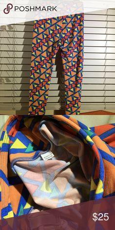 New never worn OS geometric leggings Orange and blue geometric leggings. OS. Never worn. Brand new. Made in China. Thoroughly inspected and hole free. LuLaRoe Pants Leggings