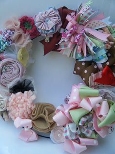 Clippie Wreath!  What a pretty solution for displaying and organizing (!) hair bows!!