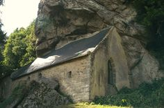 """""""The Chapel of St-Gildas sits upon the bank of the Canal du Blavet in Brittany, France. Built like a stone barn into the base of a bare rocky cliff, this was once a holy place of the Druids. Gildas appears to have travelled widely throughout the Celtic world of Corwall, Wales, Ireland and Scotland. He arrived in Brittany in about AD 540 and is said to have preached Christianity to the people from a rough pulpit now said contained within the church"""""""