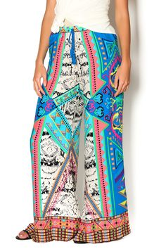 Vibrant printed flared pants with an elastic waistband and fauxdrawstring. Wear these pants with a flowy tank tucked in and mules.   Print Flared Pants by Flying Tomato. Clothing - Bottoms - Pants & Leggings - Flare & Wide Leg Chicago, Illinois