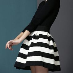 Classy & Chic B/W skirt ***only one*** Brand new with tags. **Only 1 medium**  This gorgeous skirt features horizontal white and black lines. So chic and classy make this designer piece a staple in your closet Pair with a black top, blazer and heels or with a playful white top and booties with a denim jacket. Striped   Zipper detail in back  Stretchy material. Overall length 18 inches  80% polyester 20% elastic Size M  No trades Price is firm  (((Model isn't wearing exact skirt, it is an…