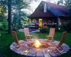 Fill your life space with things that make you happy. I have plans for a backyard garden with wildflowers and a built-in fire pit like this one. It will take years to get it just the way I want it, but part of happiness involves taking little steps along the way to a greater goal.