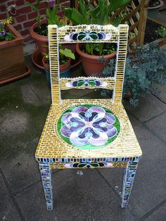 Art  Mosaic chair Pinned from Pinterest; not sure of artist.  Not Mine.  I have never covered an entire chair in tesserae.