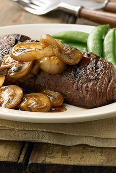 Grilled steak topped with sauteed mushrooms and onion flavored with Teriyaki stir fry sauce