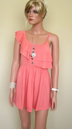 """Bangkok Bazaar Mini Dress $15.00  --  Asymmetric ruffle cotton summer dress from Thailand. Can be worn as a mini-dress or with shorts. Pair it with the Crocodile Fashion Belt (found in """"Accessories""""). This dress is daringly mini!     Available in Coral, Navy or Yellow.     Size XS only  http://www.avaadorn.com/bangkok-bazaar-mini-dress-p-205.html"""