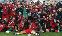 Portugal's forward Cristiano Ronaldo (centre) and his teammates pose with the trophy