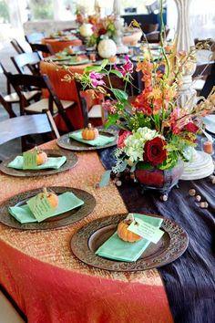 Pumpkin Place Cards    Mini pumpkins double as place cards for each guest.