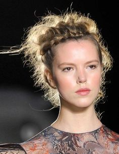 Embrace natural frizz and flyaways with this textured style