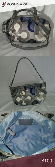 Authentic Coach purse !!! Cute Coach purse. Used a few times. Grey, white and blue with a blue lining inside. Two different straps. Does have one large inner pocket and two smaller pockets on the opposite side. No stains, scratches, rips snags or tears. Coach Bags