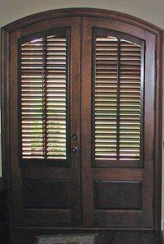 Arched stained doors can be covered with custom stained plantation shutters by The Louver Shop. Arched Front Door, Front Doors With Windows, Arched Doors, Entry Doors, Front Stoop, Arched Windows, Front Entry, Arched Interior Doors, Interior And Exterior Angles