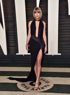 Taylor Swift wears an Alexandre Vauthier Haute Couture high-slit gown with gold heels and a gold choker