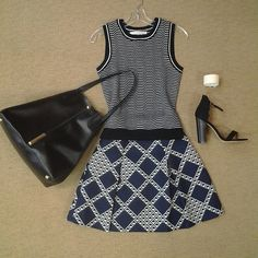 @trinaturk Lexie knit vest,@trinaturk Ferne graphic flare skirt, @raoulfashion Marion tote, @chineselaundry Sea breeze black suede sandal, and white embossed leather cuff.
