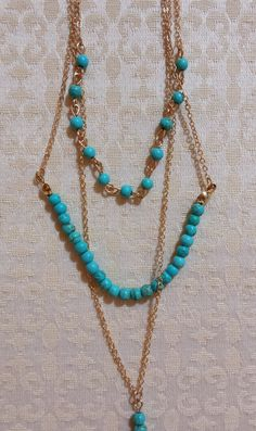 Check out this item in my Etsy shop https://www.etsy.com/listing/256509323/gold-tone-3-layer-necklace
