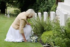 Camilla, Duchess of Cornwall visits the Commonwealth War Graves at St Nicholas' Church on July 26, 2016 in Brokenhurst, England.