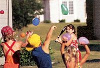 """Water-Balloon Baseball. hit a water balloon and run to the """"base"""" (a swimming pool filled with water) each fielder has a pile of balloons to try and get the runners out by throwing balloons at them. so fun"""