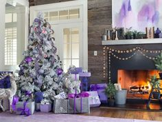 Whether your home is traditional, contemporary or shabby chic, choose a tree color and theme that fit your design. This beautiful purple and pink flocked tree is a perfect accompaniment to the cool, purple decor in this eclectic living room.