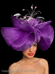 Purple blossom hat in crin and sinamay. Some fancy restaurant is missing their dining table centerpiece. I'm surprised I do, but I think it's because it is styled so beautifully. Just like a purple wildflower, in the spring. Purple hat - a bit too far ou Red Hat Society, Crazy Hats, Church Hats, Fancy Hats, Kentucky Derby Hats, Fascinators, Headpieces, Wedding Hats, Love Hat