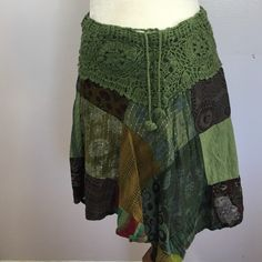 """Jayli Crocheted Boho Skirt Absolutely one of my favorites!!  Mixed media patchwork designed cotton skirt with a fully crochtwaistband! FABULOUS! No size tag- fits like a Med. Waist- 16"""". Length- 18 1/2"""". Excellent condition  Jayli Skirts"""