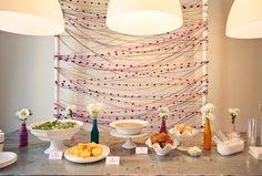 magenta, teal, and mustard yarn strung backdrop #party #decor, photo: Gabriel Ryan Photography
