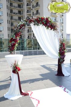 Gorgeous berry toned wedding arch and ceremony decorations!