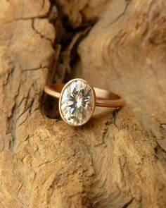 Oval Moissanite Bezel Set Solitaire by kateszabone on Etsy, $1895.00. LOVE this Oval Cut stone and simple setting